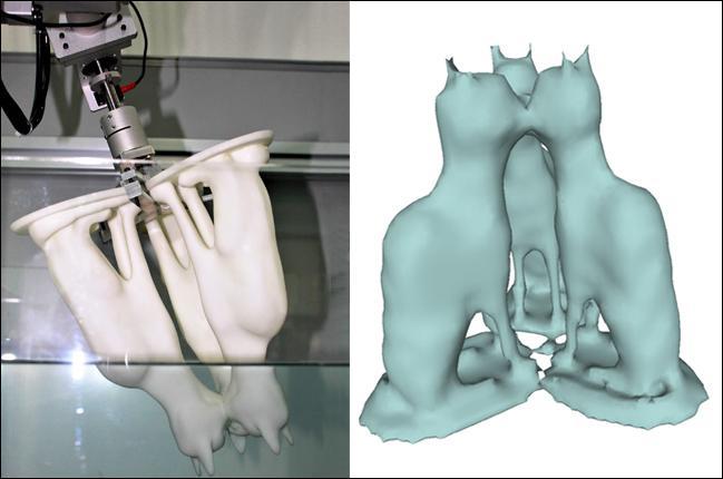Robotická ruku namáčející skenovaný předmět, vlevo zrekonstruovaná podoba (foto  ACM SIGGRAPH 2017).